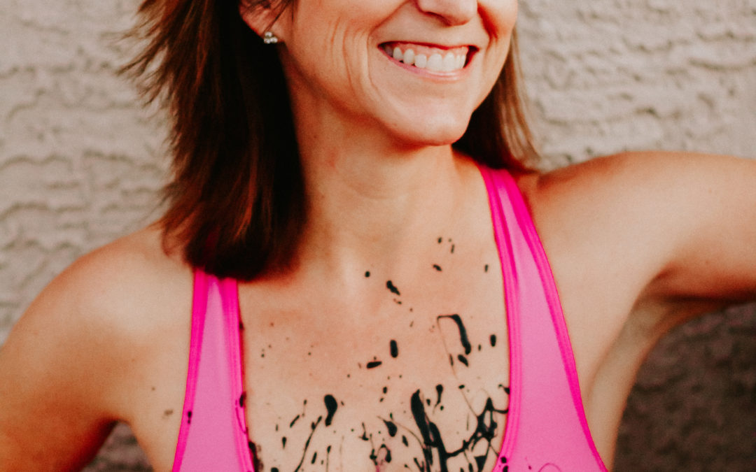 A Super-Stretchy Too-Tight Hot Pink Sports Bra Splattered in Black Paint